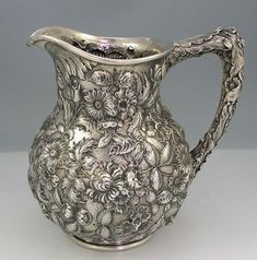 Kirk Repousse Sterling Silver Pitcher. I have a set of this Silverware from my great grandmother, wasn't aware there are pitchers for it!