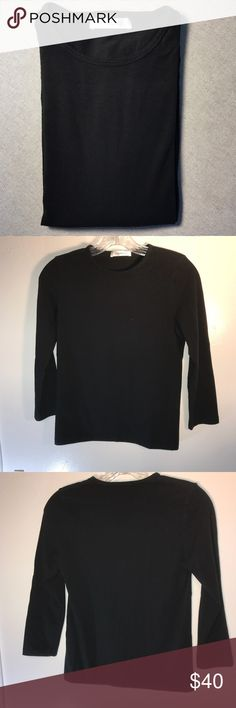 "Rivamonti Bruno Cucinelli  Long Sleeve T Shirt L Black long sleeve cotton tee by Rivamonti (by Brunello Cucinelli). Lightweight, soft and stretchy. This is a luxurious basic to have your in your wardrobe and wear all year round.  Made in Italy Size L Shoulder to Shoulder:13"" Sleeve:18 1/2"" Bust:34""-36"" Total length:22"" 90 % Cotton 10 % Lycra Rivamonti Tops Tees - Long Sleeve"