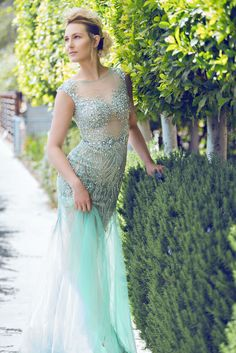 Miss California Bree Morse presenting our #prom2016 hot-seller dress in aqua color. Style: 1611P0227