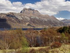 """Beinn Eighe-Britain's oldest National Nature Reserve - now designated a UNESCO Biosphere Reserve. The lower hillsides are home to 350 year old Scots pines (affectionately called """"granny """" pines) and the oldest rocks here (indeed the oldest in the world) are Lewissian gneiss, dating back some 3 billion years."""