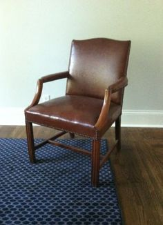 Minneapolis: vintage leather chair with wood frame $75 - http://furnishlyst.com/listings/476114