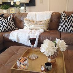 Pin for Later: 101 Amazing Pieces You'd Never Guess Were From HomeGoods The finds: a metallic pillow and a gilded tray. Brown Couch Living Room, New Living Room, Home And Living, Black Couch Decor, Black Decor, Home Goods Decor, Home Decor, Brown Sofa, Room Colors