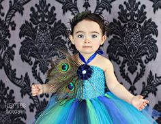 baby girls peacock tutu dress -  12, 18, 24 months  -  three large peacock eye feathers and matching feather pad headband. $59.00, via Etsy.
