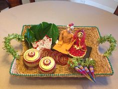 Gye holud daala. Termuric, paan, henna tubes, Churi (glass red bangles), bride & groom dolls. Created by Sonia Kazi, Dallas
