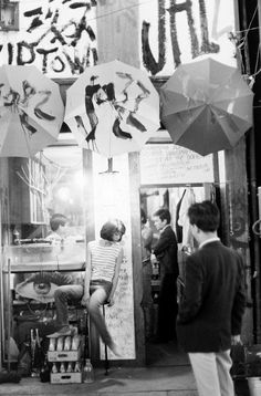 Photo of a Japanese teenager outside a bar in Japan by Michael Rougier for LIFE, 1964.