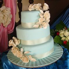 A lovely blue and ivory cake found on http://joyofpastries.wordpress.com/2011/11/20/sky-blue-wedding-cake-2/