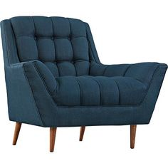 Inspired by classic regal designs, this mid-century modern blue armchair features a beautifully tufted seat and back.