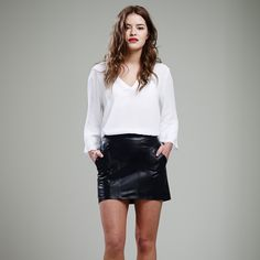 This black mini skirt is hand made of luxuriously soft genuine leather. It features a simple decorative stitching and a zip for fastening. A great fashion accessory for year-round, day and night.