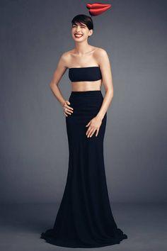 Anne Hathaway Balmain bandeau and skirt, $4,600; Philip Treacy hat