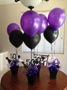 These are centerpieces I made for my Brother and his Wife's 50th Birthday Party.  I used my Cricut II, specialty scrapbooking papers, floral wire, a glue gun, some metal planters, and some balloon weights.