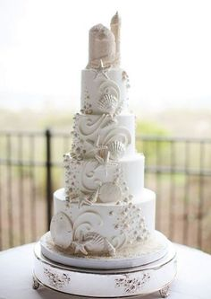 Love the idea of a Beach (or Ariel-themed) wedding but want to stay away from the usual blues and greens associated with it?  Here's a gorgeous wedding cake in pale neutrals that is the perfect inspiration!