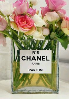Love using used but still classy receptacles for other things. Here, a perfume bottle as a vase