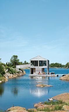 Cedar slats mark the facade of the Worple's lakefront vacation home in Ontario.
