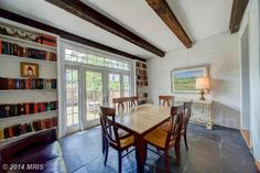An open and inviting home library that doubles as an office space. It's bright as well as functional. Washington, DC Coldwell Banker Residential Brokerage