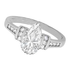 Pear Shaped Diamond Engagement Ring with Channel Set Round Diamonds 0.42 tcw. In 14K White Gold
