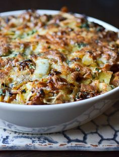 """""""Ham and Cheese"""" Breakfast Casserole - This is one to memorize, folks, and to pull out for in-laws and overnight guests. It's  baked in layers, like a strata, with the bread on the bottom, then the pancetta, cheese, and herbs."""