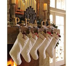 Channel Quilted Velvet Stocking | Pottery Barn  would love to have these in white for the fam!