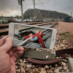 Artist inserts movie scenes into real life situations using their iPhone