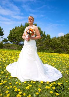 A Bride in a field of yellow flowers @ the Albion River Inn.  | by Christopher Armstrong Photography