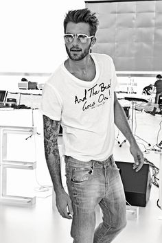tattered jeans and v neck t shirt... the beard and tats have nothing to do with how sexy this is.... I swear...