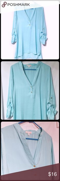 NWT Gianni Bini Turquoise Flowing Long  Top SZ LG Beautiful flowing Turquoise Tunic by Gianni Bini. The material looks like Silk but is poly. The gold buttons and roll up buttons add another zest to this classy piece. This is NWT in ready to wear condition. Enjoy! Gianni Bini Tops