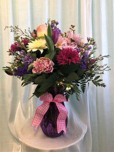 Carnations, gerbera daisy, tulip, stock, roses, statice waxflower