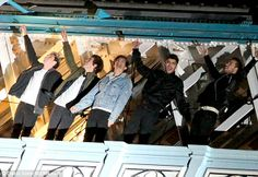 Lofty new heights: One Direction film new scenes for their music video on Tower Bridge in London