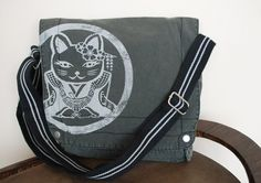 Lucky cat messenger bag--so cute.  I am a bagaholic, really.