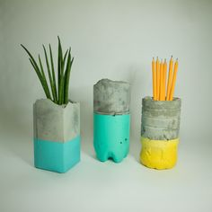 New planter/pencil holder casts made from tonic water, orange juice and cordial packaging