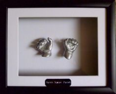 two cute plaster casting hands in silver by www.keepsake4u.com.au
