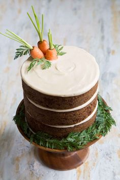 Celebrate the start of Spring with this layered carrot cake lightly frosted with brown sugar cream cheese. Minimally decorated with fresh carrots, this is an easy cake everyone can make!