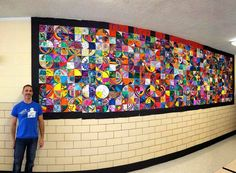 School-wide art project: Every member of the school community made a 1/4 circle. http://fabulousinfirst.blogspot.com/2014/09/linking-up-late.html
