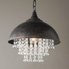 "Metal Dome Pendant with Crystals This rustic bronze metal dome has urban appeal with added flair from chic strands of waterfall faux crystal droplets underneath. 1-40watt medium base. Includes 32"" of chain with 5"" round mounting canopy for total max height of 42"". (15""Hx13.25""W)"