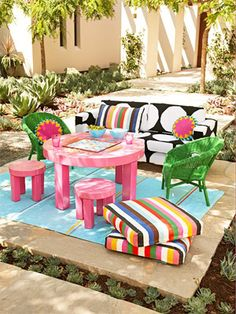 A patio or deck situated in the shade of a big tree is the perfect place to roll out a rug, arrange some furniture and create an instant room.