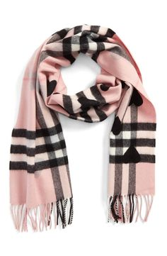 Featuring Burberry's signature check pattern, this cashmere scarf will keep you super cozy and fashionable when the days start to cool.