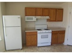 24. Builder's kitchen before by Lennar Homes, 2004. In 2015, the buyer wants stainless !