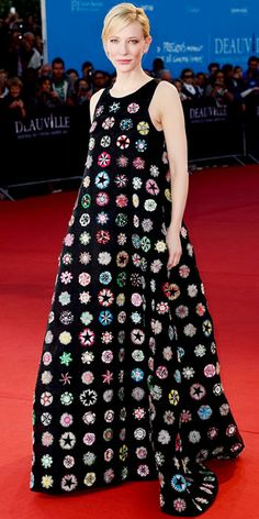 Cate Blanchett wearing a sleeveless Christian Dior Couture gown with colorful embroidered disc-like details.