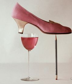 1953 Still life of pink crepe pump by Capezio.