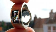 Sooo cool. It is a ring that projects an image when you shine light through it.