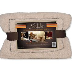 """The Nuddle Blanket — """"This is definitely a must-have travel item! I swear it's the best blanket ever because you can tuck your feet into a pocket, slip your arms through open coverings, and fold it into a compact square when you need to pack up. I never leave home without mine."""""""