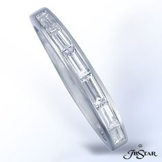 JB Star Platinum diamond wedding band handcrafted with 6 perfectly matched baguettes in channel setting.