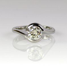 handmade Twist ring set with one carat round brilliant diamond on platinum