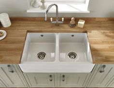 Lamona White Ceramic Double Belfast Sink - this would allow for cutting board on TOP