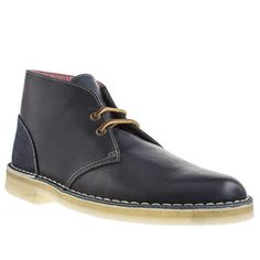 It's the meeting of two icons here, as Clarks Originals collaborate with Canadian luggage brand Herschel Supply Co. The signature Desert boot arrives in navy leather and features a contemporary denim heel panel with red and white striped lining for a fres                                    <br><br><ul><li>Leather upper</li><li>Fabric lining</li><li>Rubber crepe sole</li><li>Clarks Originals X Herschel Supply Co. </li></ul>