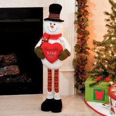 The Warmest Holiday Wishes Plush Snowman Statue will add a cozy touch to your home! #kirklands #holidaydecor