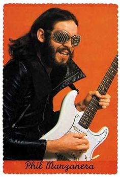 Roxy Music's Phil Manzanera and his amazing fly's eyes sunglasses. Such a fantastic guitarist, love his playing on Re-make Re-model, a great song full of dissonance.