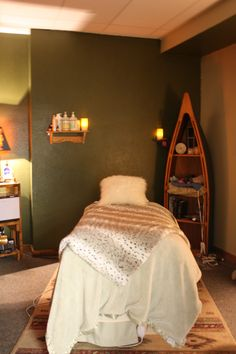 I like this room, and the preparedness of the therapist.  An architecturally interesting shelf is perfect for the decor, but pulls double duty holding various warmers, supplies etc. A hot towel cabi on the left is tucked in an small alcove, ready for creating those yummy towels providing moist heat,or rubber bowls with your oil or lotion to warm it. Lots of uses, and multitaskers like that more than pay for the space they use....This room makes me want to book a treatment =)