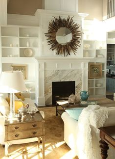 How To Pull Off An Eclectic Look In A Living Room. I love this mirror! Looks like a basic round mirror with twigs glued around it.