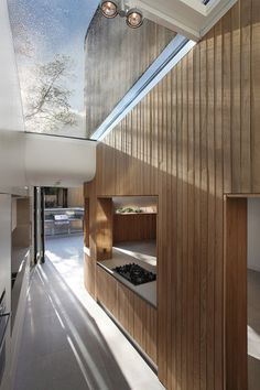 Interior shot of a residence in Hackney that features a curvy timber extension