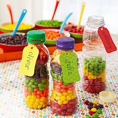 {Take-home Treats}  Kids will have fun layering colored Skittles or M&M's in recycled plastic bottles to make a yummy favor.